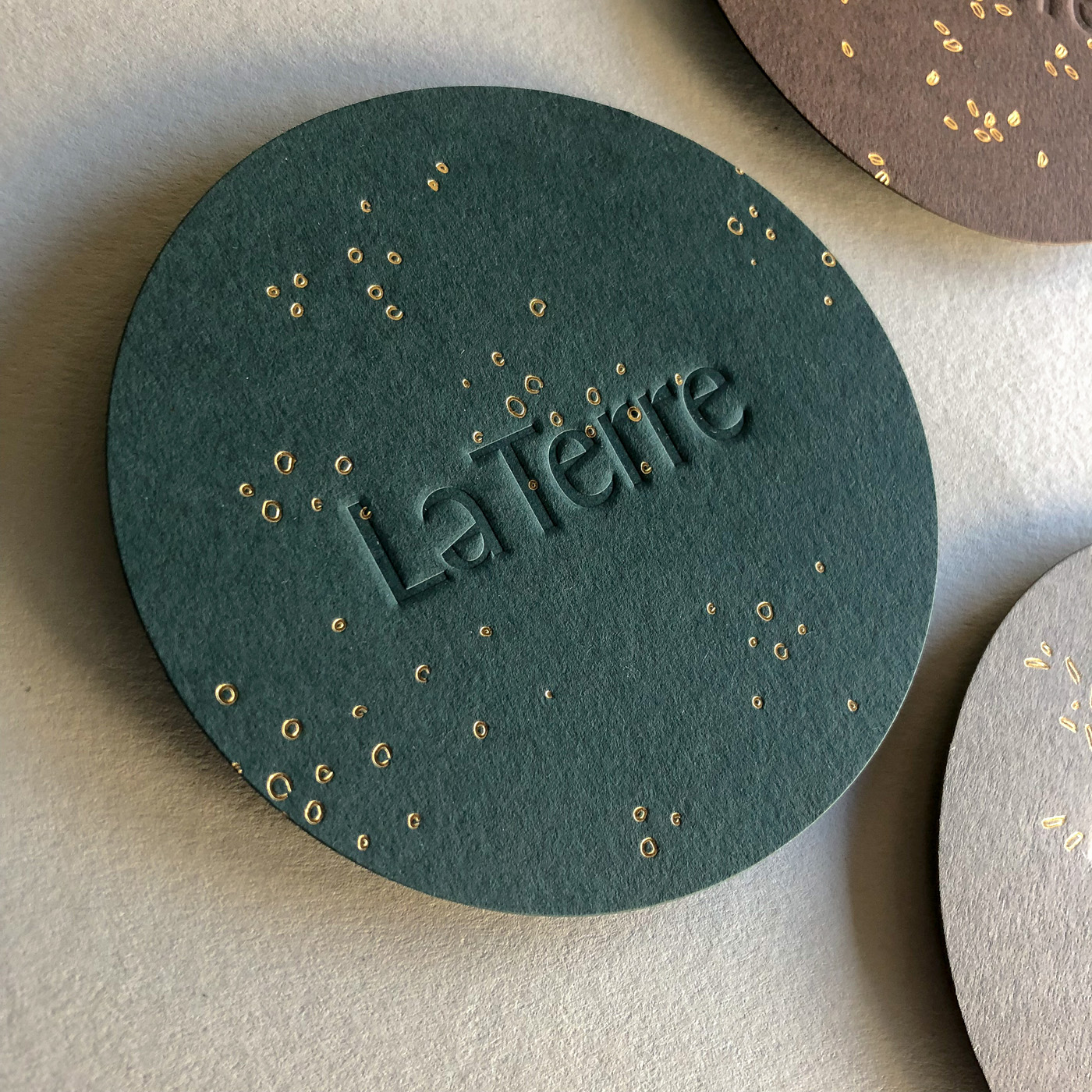 Gold foil printing and letterpress printing on coasters for La Terre on Colorplan 1