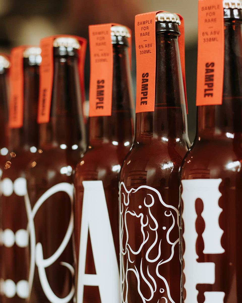 Specialty letterpress beer neck labels for Sample Brew on Colorplan 1