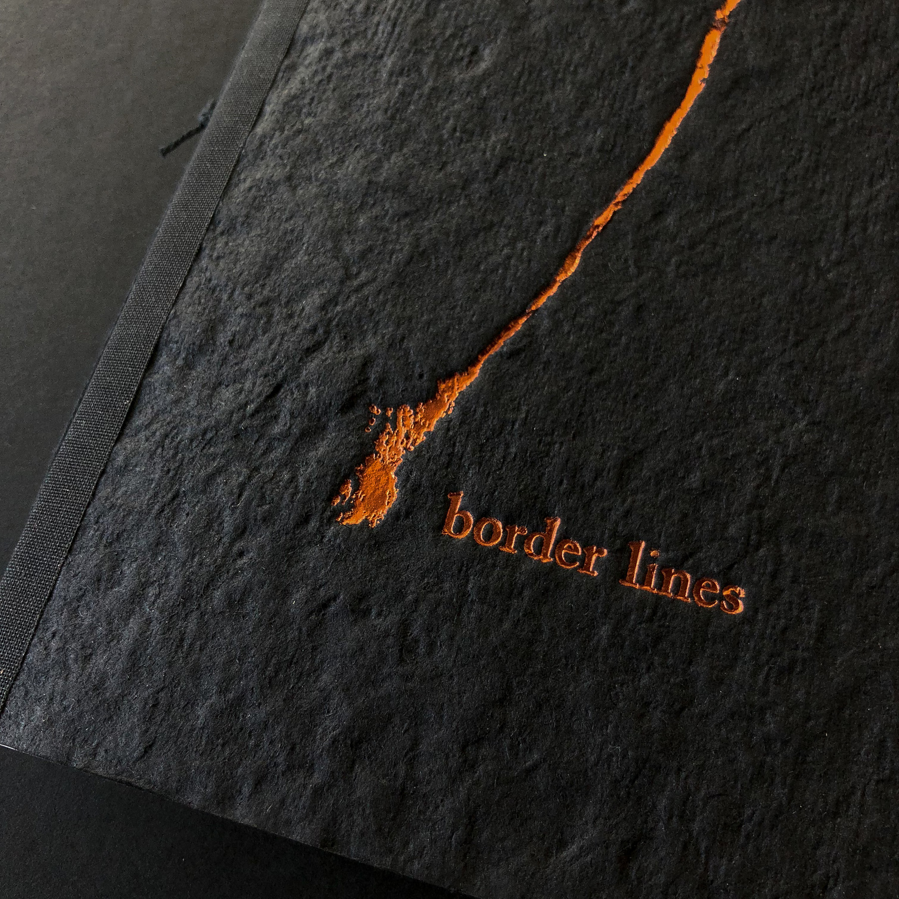 Copper foil stamped book by Lloyd Jones on handmade paper cover 1