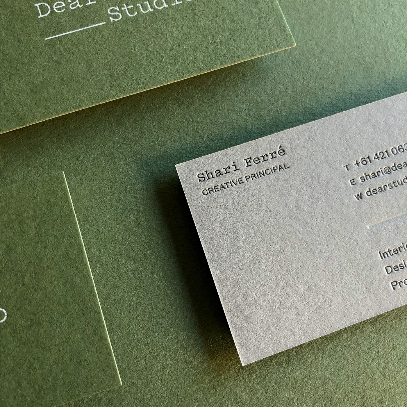 Duplex letterpress blind white foil business cards for Dear Studio on  Colorplan Mid Green and Real Grey 1