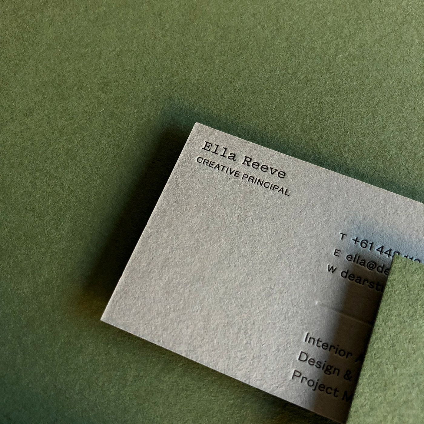 Duplex letterpress blind white foil business cards for Dear Studio on  Colorplan Mid Green and Real Grey 2