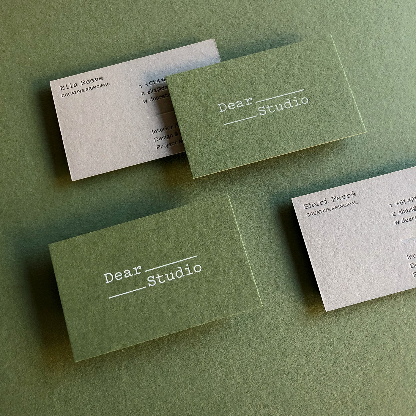 Duplex letterpress blind white foil business cards for Dear Studio on  Colorplan Mid Green and Real Grey 3
