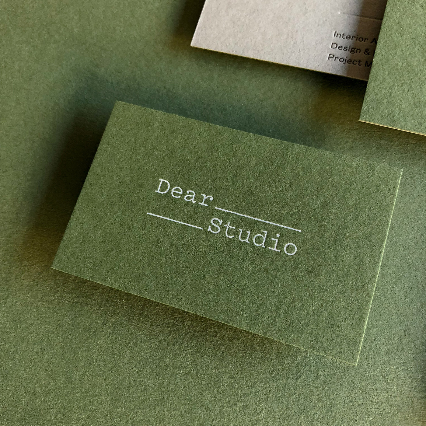 Duplex letterpress blind white foil business cards for Dear Studio on  Colorplan Mid Green and Real Grey 4