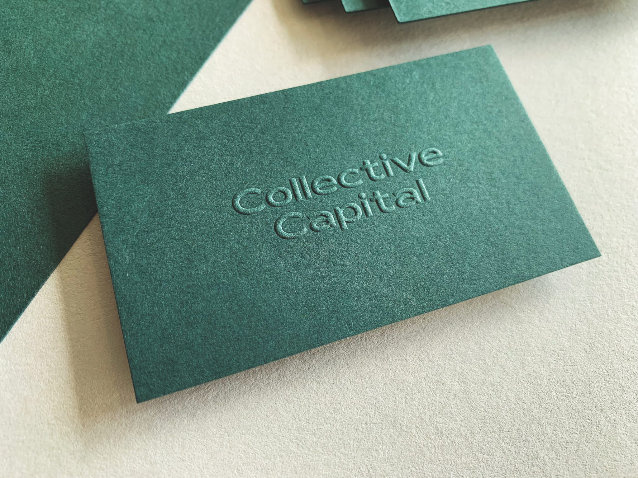 Embossed Opaque White Digital Business Cards for Collective Capital on Colorplan 2