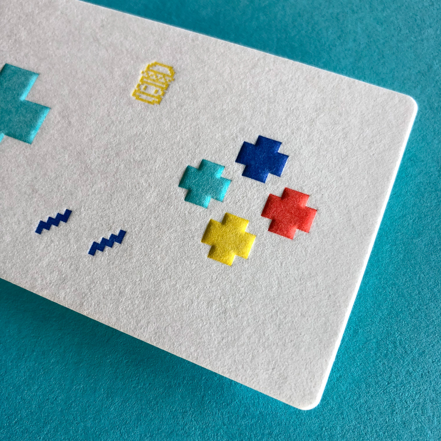 Unique letterpress embossed business cards for 8 Bit Burger on Wild 3