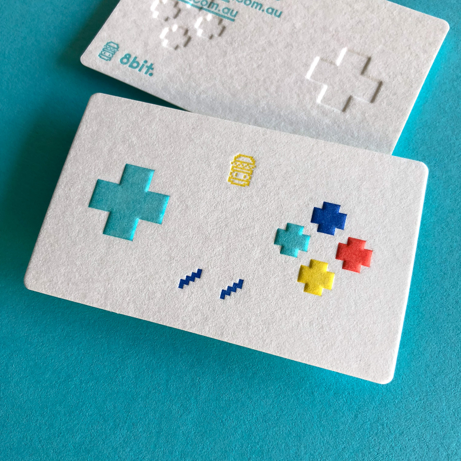 Unique letterpress embossed business cards for 8 Bit Burger on Wild