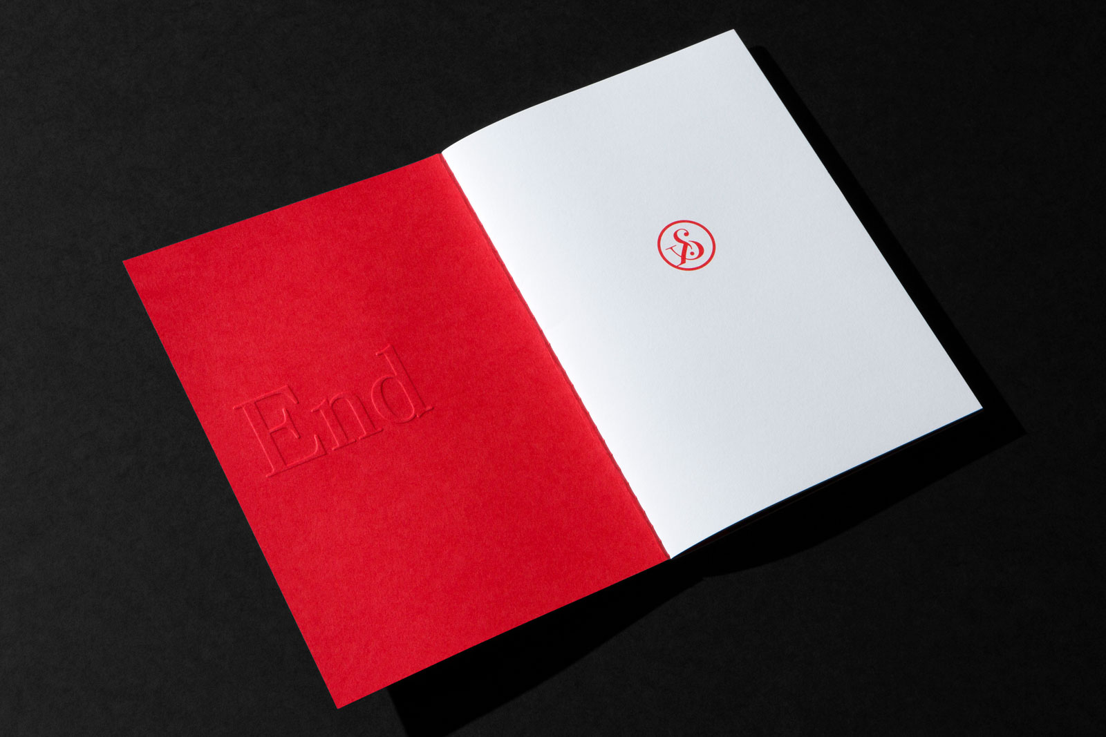 Embossed Brand Book for PAN on Colorplan Bright Red and Colorplan Mist and Colorplan Pristine White 2