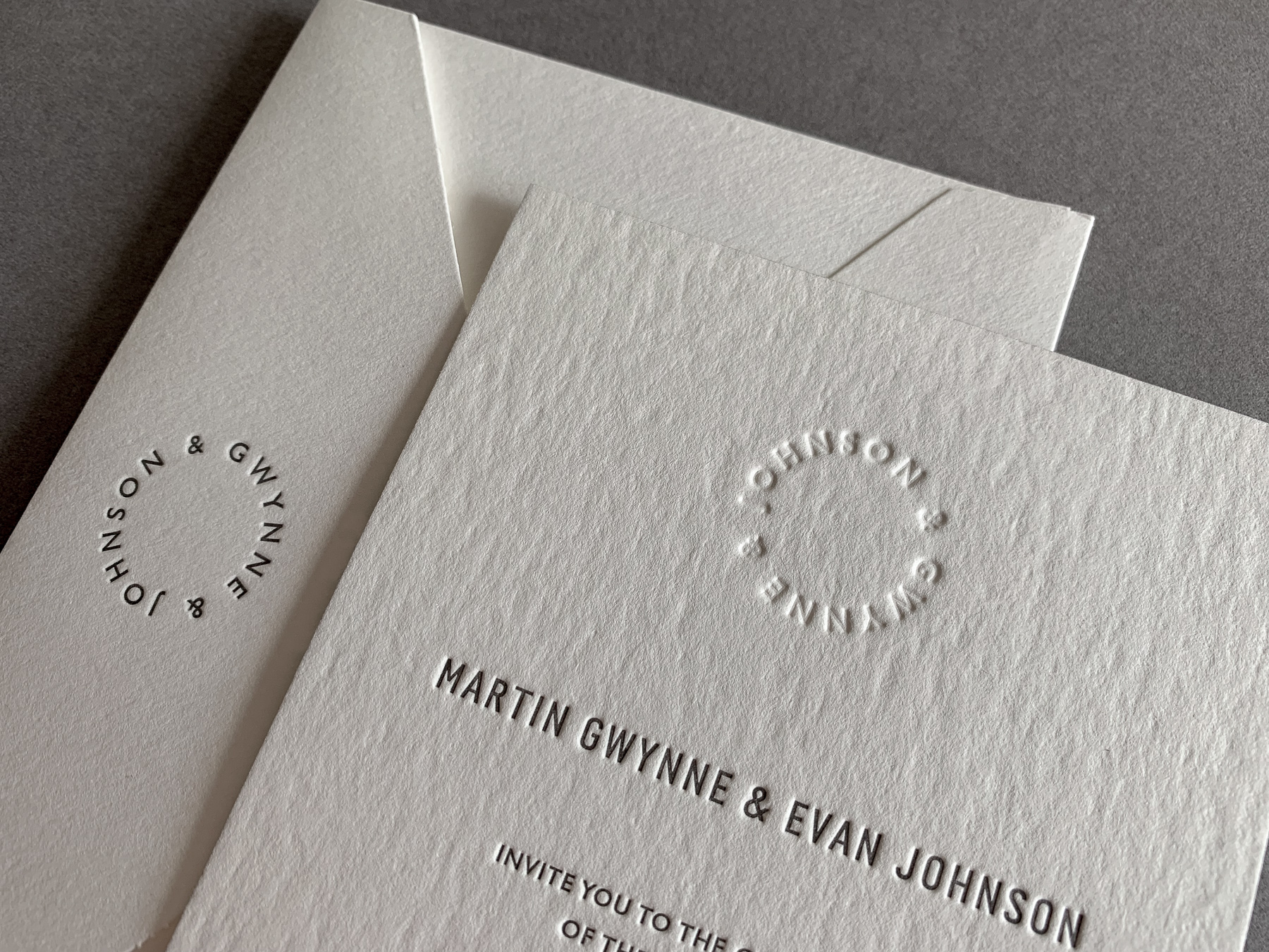 modern-wedding-invitations-letterpress-blind-monogram-evan-and-martin-on-wild-1